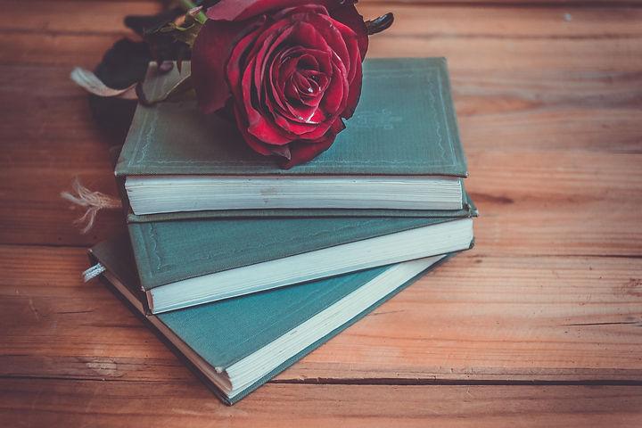 Red roses on books.jpg