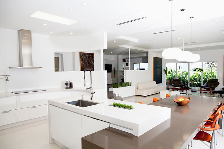 White kitchen, open plan living, orange accent, bright and airy space