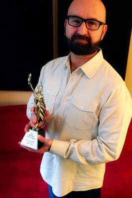 David_L_Brehm_w_Platinum_Marcom_Award.jp