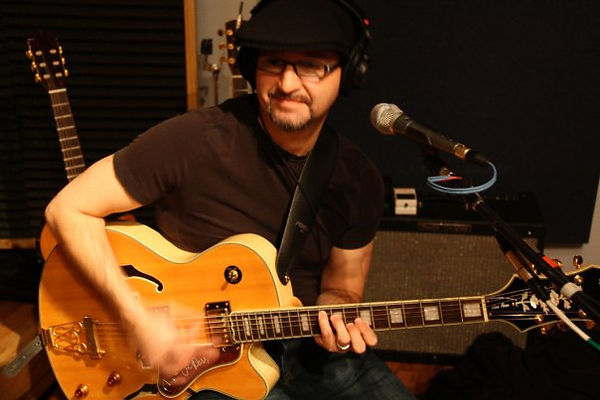 David_Lee_Brehm_on_guitar.jpg
