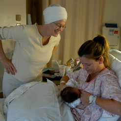 Birth of my own daughter with our beloved midwife, Davi Khalsa