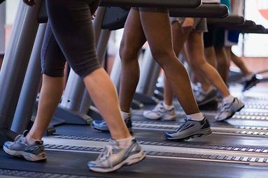 People exercising on treadmill