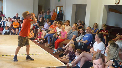 Young Storyfair storyteller onstage at t