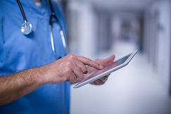 male-surgeon-using-digital-tablet-operat