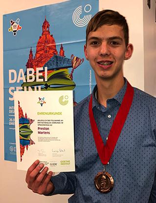 Preston Martens places fourth at International German Olympics