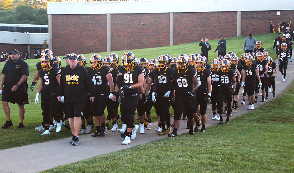 The Bulldogs make their traditional walk to TouVelle Stadium just before kickoff.
