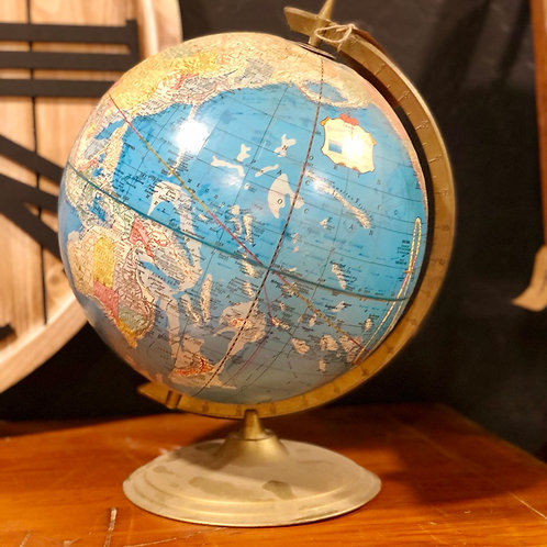 Vintage globe on metal base