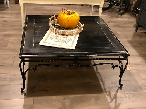 Black coffee table with metal base