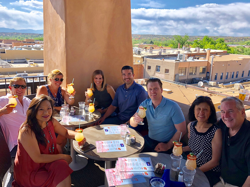Guests of the bell tower bar at la fonda santa fe enjoying the best margaritas in Santa Fe New Mexico