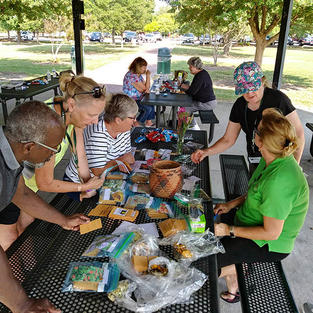 Swapping seeds at our annual picnic meeting