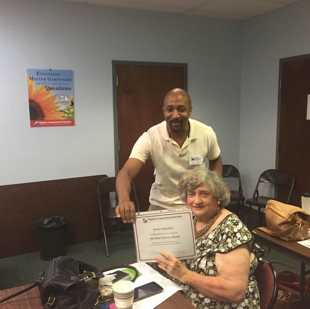 Susan Schneider receives milestone award from Jeffrey Williams