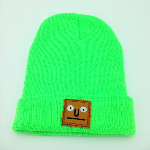 c47d5737 Designed and assembled by hand in the UK. A soft, green beanie with  embroidered brown square face design.