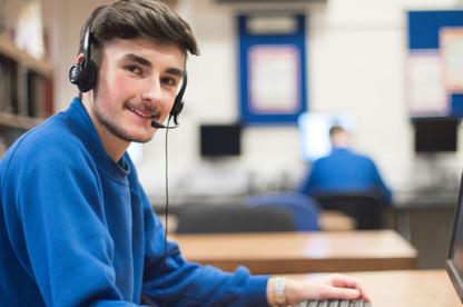 Student enjoying a Tute online lesson