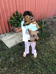 Isabella holding Hugo