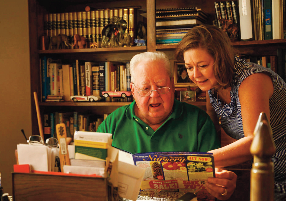 Sheree Rose Kelley and her father look at a seed catalog