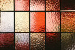 Stained glass window pane in red/orange