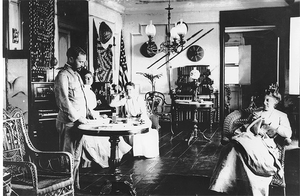 Frederick Funston and wife, Edna, spend an afternoon in their living room of the home they would ultimately lose in the 1906 inferno.
