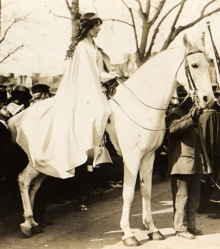 Lawyer Inez Boissevain, wearing white cape, seated on white horse at the National American Woman Suffrage Association parade on March 3, 1913, in Washington, D.C. (Wikipedia/George Grantham Bain Collection)