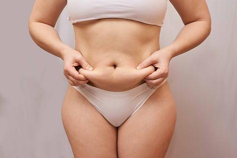 bigstock-Fat-Unhealthy-Woman-Body-Pinc-3