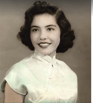 Black and white image of a young woman that's been restored from a damaged photo
