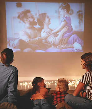 Family gathered to watch family vacation video
