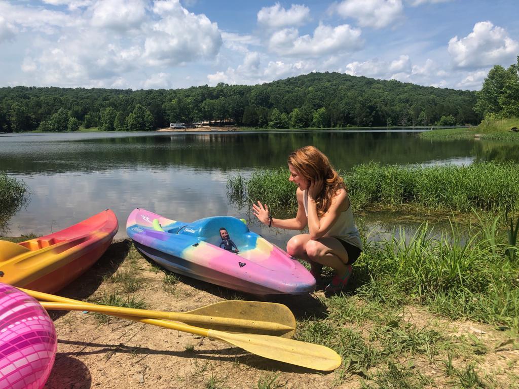 Cassandra kayaking with mini-Ray