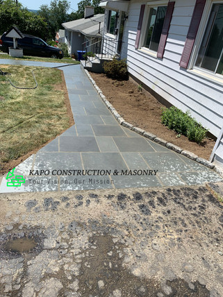 Bluestone walkway with cobble stone edging