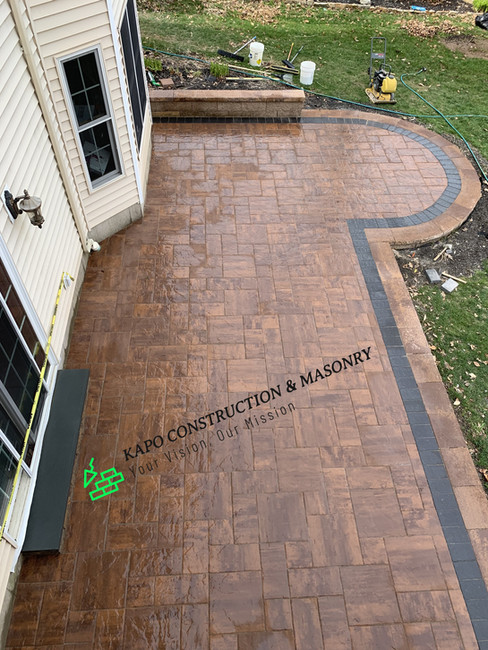 Paver patio, sitting wall & bluestone step