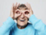 Elderly lady being silly. Laughter Care Laugh Therapy UK workshops