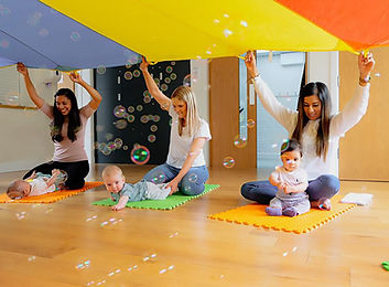 Mothers and babies enjoying bubbles and parachute time at Baby Sparks Sensory Little Sparks Class.jpg
