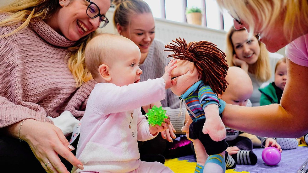Baby and mums at Baby Sparks sensory class. Baby development