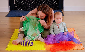 Mum playing peekaboo with children at Baby Sparks Sensory Little Shakers Class.JPEG