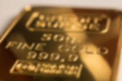 The surface of minted gold bar weighing