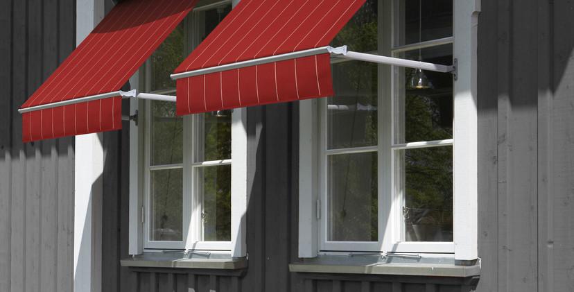 rödamarkiserpåmörkgråtthus.jpg