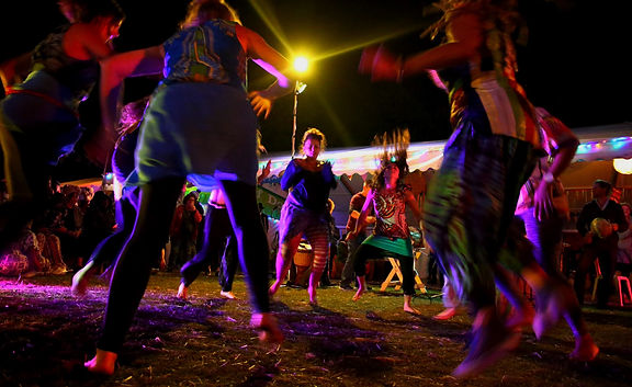 People dancing in colourful lights
