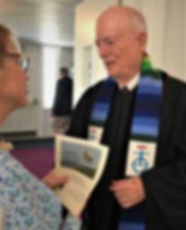 David Felton greets Linda Grant Reiman.J