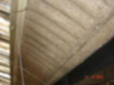 Asbestos spray coating on the underside of an asbestos cement roof,from anasbestos reinspection survey in Cwmbran, 2007