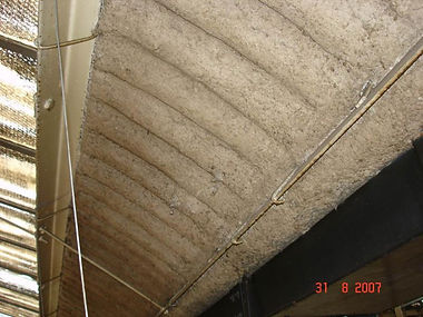 Asbestos spray coating on the underside of an asbestos cement roof, from an asbestos reinspection survey in Cwmbran, 2007