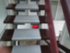 Asbestos-reinforced stair nosing from an asbestos management survey in Saundersfoot, Pembrokeshire, 2015