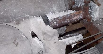 Damaged asbestos pipe insulation in Merthyr Tydfil