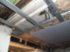 Damaged ceiling panels, asbestos insulating board, from an asbestos refurbishment survey in Heath, Cardiff, 2013