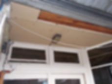 Porch ceiling panels, asbestos insulating board, from an asbestos refurbishment survey in Caerphilly, 2015