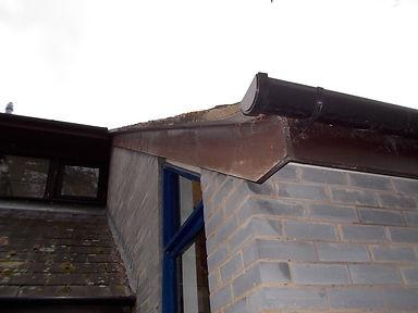 Asbestos cement undercloaking from an asbestos refurbishment survey in Llanelwed, Powys, 2014