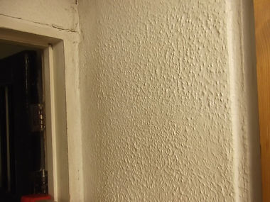"""Asbestos-containing """"artex""""-type decorative wall coating from an asbestos refurbishment survey in Laugharne, Carmarthenshire, 2014"""