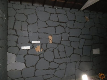 Asbestos paper-lined fibreboard in Cardiff, confirmed by bulk sampling, 2013