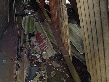 Damaged asbestos cement wall cladding from a Type 2 asbestos survey in Bridgend Industrial Estate, Bridgend, 2005