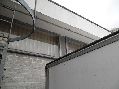 Asbestos cement panel between windows, from an asbestos refurbishment survey in Cardiff, 2012