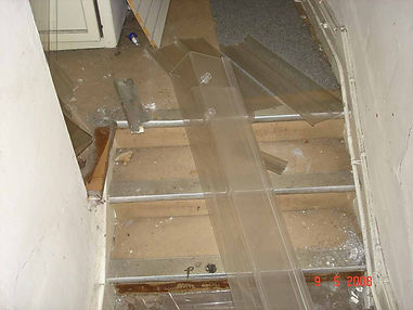 Asbestos-reinforced stair nosing from a Type 3 asbestos survey in Llanelli, 2005