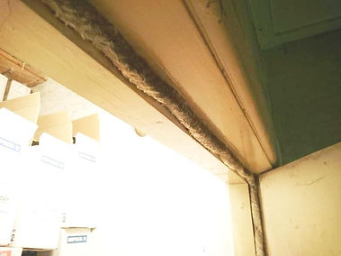 Asbestos rope in a door framefrom an asbestos management survey in Newport, 2016