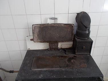 Asbestos textile gasket on oven from anasbestos refurbishment survey in Dryslwyn, Carmarthen, 2014